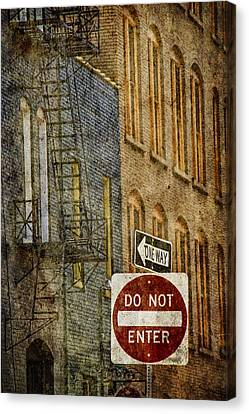 One Way And Do Not Enter Signs In Front Of High Rise Building With Fire Escape Canvas Print