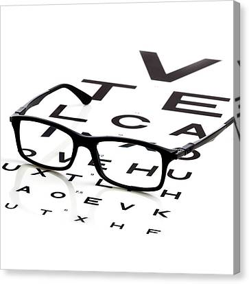 Opticians Chart And A Pair Of Glasses Canvas Print by Science Photo Library