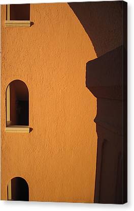 Canvas Print featuring the photograph Orange Building With Archway by Mary Bedy