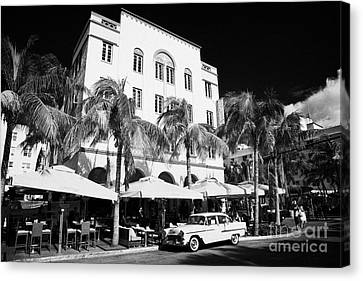 Orange Chevrolet Bel Air In The Cuban Style Outside The Edison Hotel Canvas Print by Joe Fox