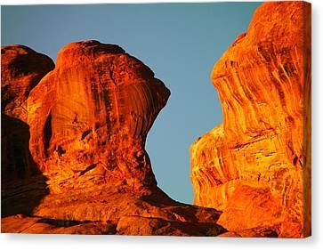 Orange Rock Foreground A Blue Sky Canvas Print