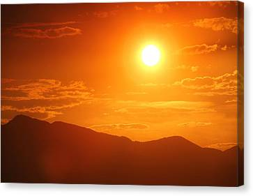 Canvas Print featuring the photograph Orange Sunset Over Mountains by Tracie Kaska