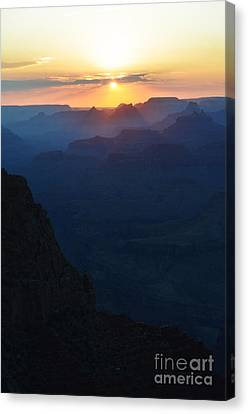 Orange Sunset Twilight Over Silhouetted Spires In Grand Canyon National Park Diffuse Glow Vertical Canvas Print