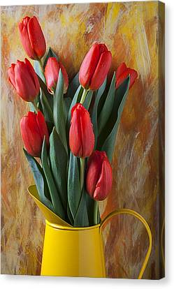 Orange Tulips In Yellow Pitcher Canvas Print by Garry Gay