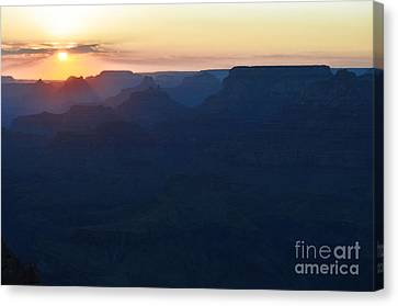 Orange Twilight Sunset Over Silhouetted Spires In Grand Canyon National Park Diffuse Glow Canvas Print