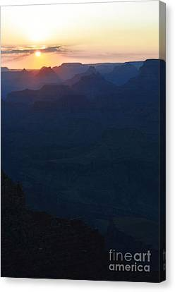 Orange Twilight Sunset Over Silhouetted Spires In Grand Canyon National Park Diffuse Glow Vertical Canvas Print