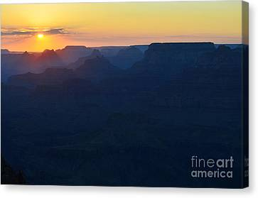 Orange Twilight Sunset Over Silhouetted Spires In Grand Canyon National Park Canvas Print by Shawn O'Brien