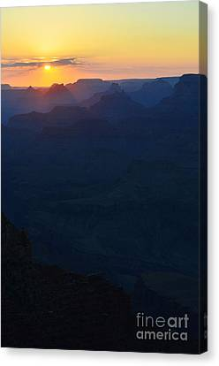 Orange Twilight Sunset Over Silhouetted Spires In Grand Canyon National Park Vertical Canvas Print by Shawn O'Brien