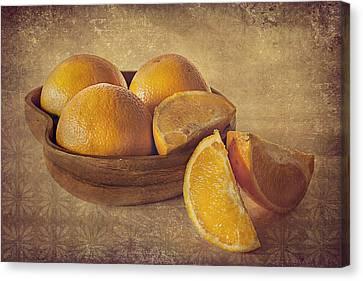 Oranges Canvas Print by Lyn Darlington