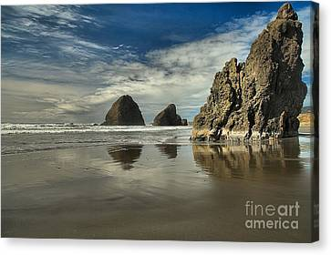 Oregon Sea Stack Reflections Canvas Print by Adam Jewell