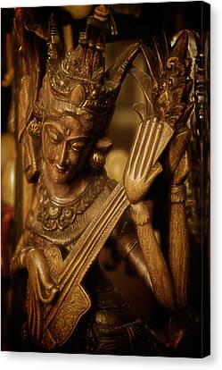 Canvas Print featuring the photograph Oriental Wooden Princess Playing Instrument by Dave Garner