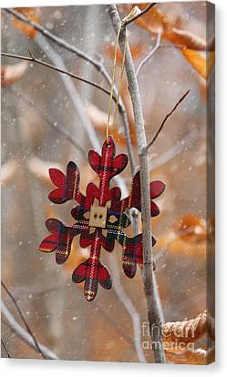 Canvas Print featuring the photograph Ornament Hanging On Branch With Snow Falling by Sandra Cunningham