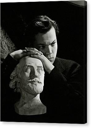 Leaning Canvas Print - Orson Welles Resting On A Sculpture by Cecil Beaton