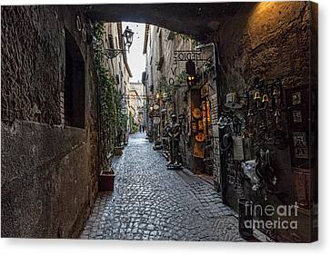 Orvieto Umbria Italy Narrow Street With Small Shops Canvas Print by Frank Bach