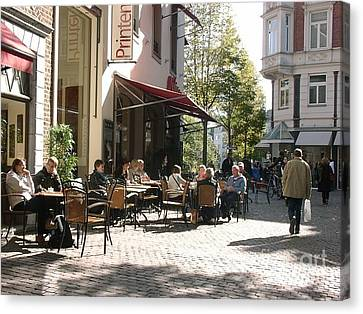 Outdoor Cafe Aachen Germany Canvas Print by Anthony Morretta