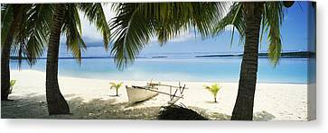 Urban Scenes Canvas Print - Outrigger Boat On The Beach, Aitutaki by Panoramic Images