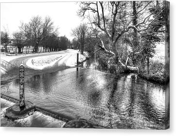 Overflowing River In Black And White Canvas Print by Gill Billington