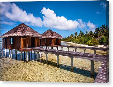 Overwater Spa Villas. Maldives Canvas Print by Jenny Rainbow