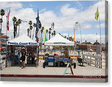 Pacific Coast Kites And Paradise Dogs On The Municipal Wharf At The Santa Cruz Beach Boardwalk Calif Canvas Print by Wingsdomain Art and Photography