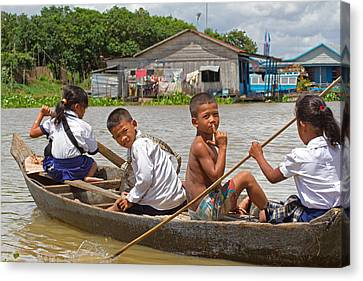 Paddling Home From School Canvas Print by David Freuthal