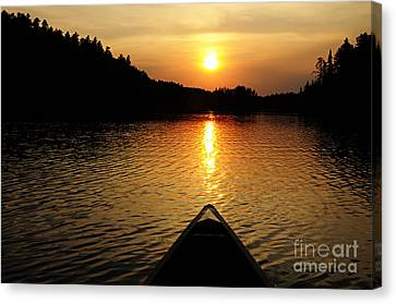Paddling Off Into The Sunset Canvas Print by Larry Ricker