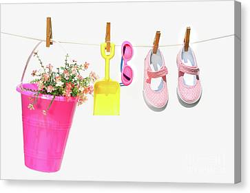 Pail And Shoes On White Canvas Print by Sandra Cunningham