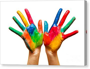 Painted Hands On White Canvas Print by Michal Bednarek
