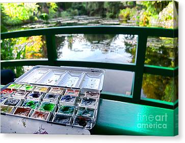 Painting In Giverny Canvas Print by Olivier Le Queinec