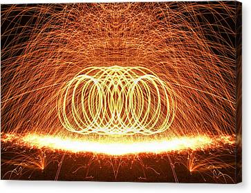 Painting The Night With Fire Canvas Print by Dan Sproul
