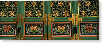 Paintings On The Door Of A Buddhist Canvas Print by Panoramic Images