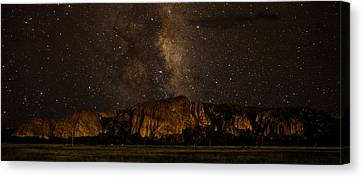 Palisades Under The Cosmos  Canvas Print by Mike Schmidt