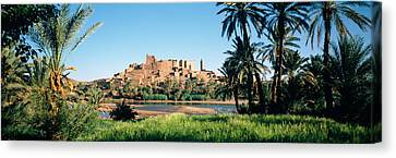 Moroccan Canvas Print - Palm Trees With A Fortress by Panoramic Images