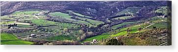 Panorama Of A Tuscan Hillside Town Canvas Print by Susan Schmitz
