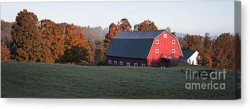 Panoramic View Of A Red Barn At Sunrise Canvas Print by Edward Fielding