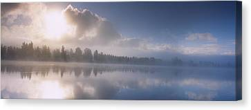 Panoramic View Of A River At Dawn Canvas Print by Panoramic Images