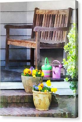 Pansies And Watering Cans On Steps Canvas Print by Susan Savad