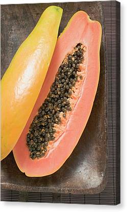 Wooden Bowl Canvas Print - Papaya, Halved, In Wooden Bowl by Foodcollection