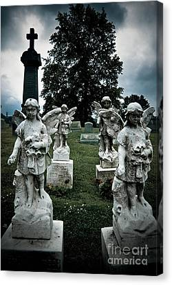 Parade Of Angels Statues At Cemetery Canvas Print