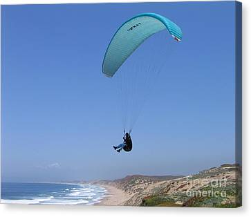 Paraglider Over Sand City Canvas Print by James B Toy