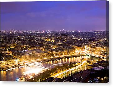 Paris And The River Seine Skyline View At Night Canvas Print by Mark E Tisdale