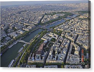 Paris And The Seine River Canvas Print by Sami Sarkis