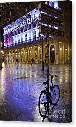 Paris Surreal Rainy Night Scene With Bicycle - Palais Royal Theatre District Rainy Night And Bicycle Canvas Print by Kathy Fornal