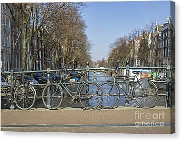 Parked Bikes On A Bridge In Amsterdam Canvas Print