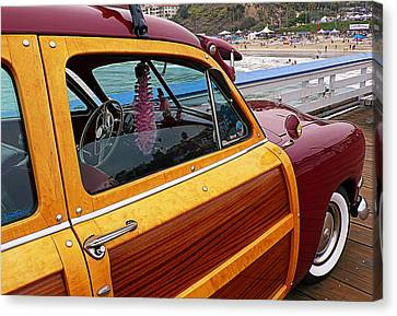 Parked On The Pier Canvas Print by Ron Regalado