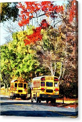 Parked School Buses Canvas Print by Susan Savad