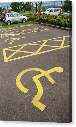 Parking Spaces For Disabled Drivers. Canvas Print by Mark Williamson
