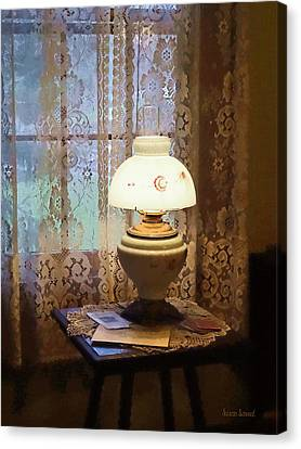 Parlor With Hurricane Lamp Canvas Print by Susan Savad