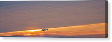 Passenger Airliner Landing At Dawn Canvas Print