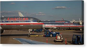 Passenger Airliners At An Airport Canvas Print