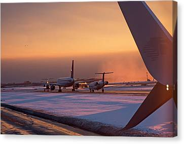 Passenger Airliners Taxiing At Dawn Canvas Print